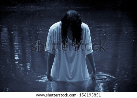 Horror Scene - the woman in the swamp - stock photo