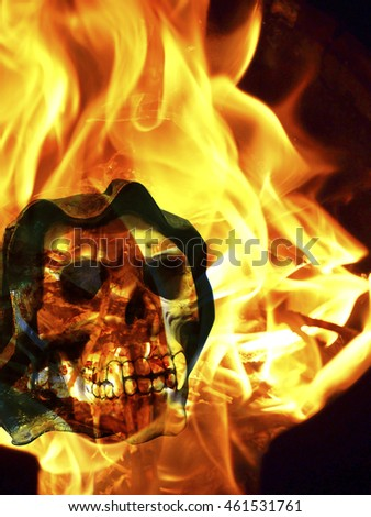 horror skull with canine teeth on fire background