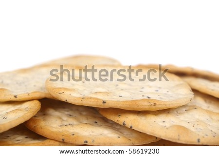 hors d'oeuvres cracker with cracked pepper isolated over white