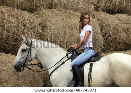 Horse and beautiful women portrait on summer evening farm