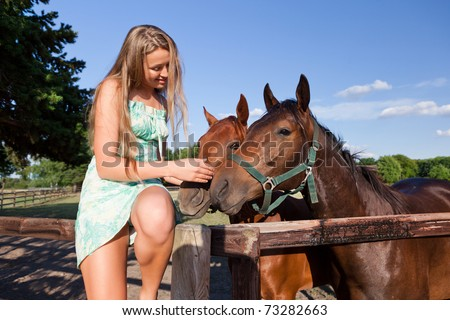 horse and blond girl in paddock on summers day
