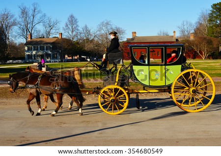 Horse and carriage in Williamsburg colonial town in Virginia in the United States of America - stock photo