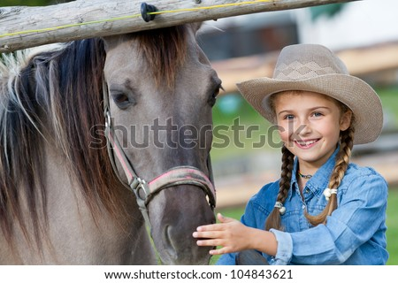 Horse and girl - Lovely cowgirl and pony on a ranch - stock photo
