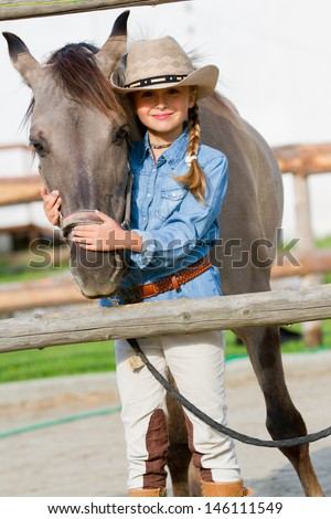 Horse and girl, ranch - Lovely girl with horse on the ranch - stock photo