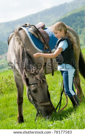 Horse and jockey - little girl and her best friend - stock photo