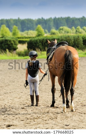Horse and lovely equestrian girl - stock photo