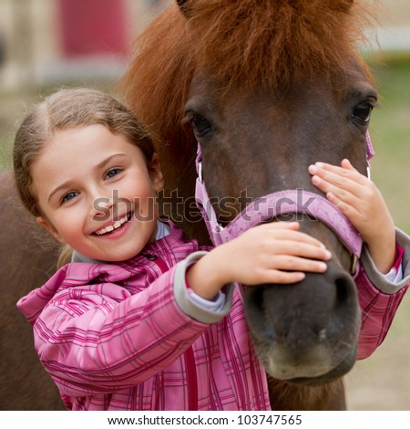 Horse and lovely girl - best friends - stock photo
