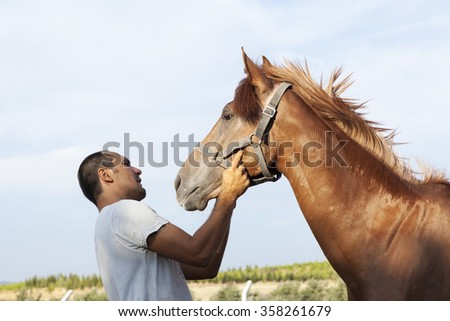 Horse And Man - stock photo