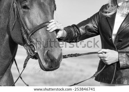 Horse and Rider outdoors, Black and White  - stock photo