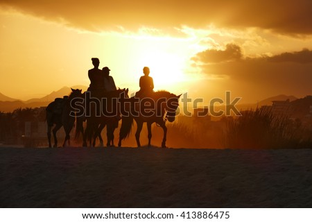 horse back ride at sunset on Mexican beach