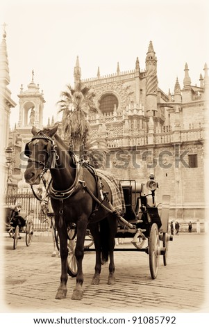 Horse carriage in front of Seville's cathedral. Vintage. - stock photo