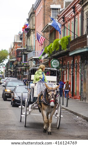 Horse-drawn cab at French Quarter New Orleans - NEW ORLEANS, LOUISIANA - APRIL 18, 2016  - stock photo