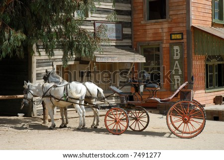 Horse-drawn carriage in a traditional American western town - stock photo