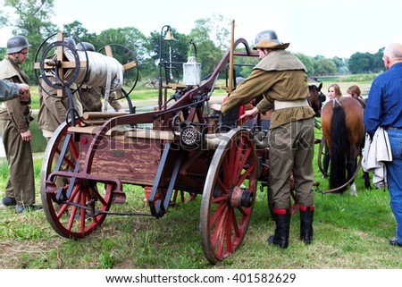 Horse-drawn german 1900s emergency fire-engine at historical event - stock photo