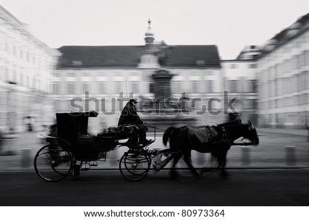 Horse-driven carriage at Hofburg palace in Vienna, Austria, black/white - stock photo