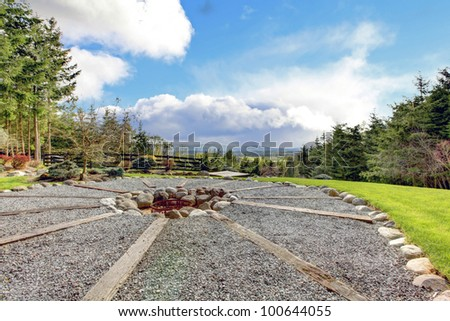 Horse farm beautiful nature view and landscape with fire pit. - stock photo