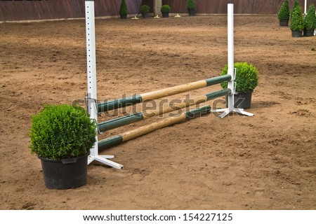Horse jumping fence - stock photo