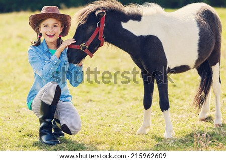 Horse - Lovely girl with pony - stock photo