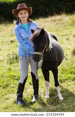 Horse - Lovely girl with pony on the ranch  - stock photo