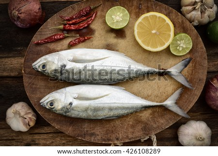 Horse mackerel at cutting table - stock photo