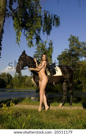 Horse, pond and girl. - stock photo