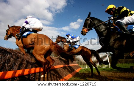 Horse Race, Jumping a Fence - stock photo