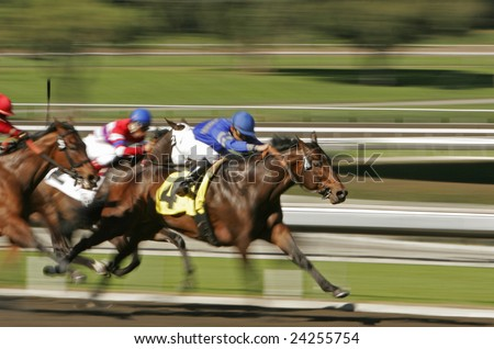 Horse race shot at slow shutter speed to enhance motion effect - stock photo