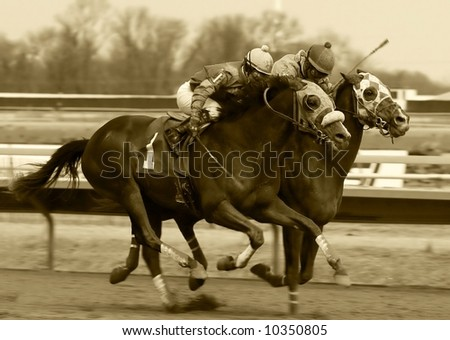 horse racing done in sepia - stock photo