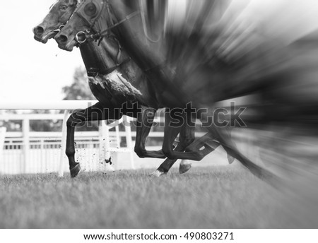horse racing, selective focus and blurred, black and white