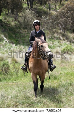 horse ridding in the green outback - stock photo