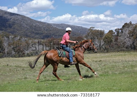 horse ridding in the green outback