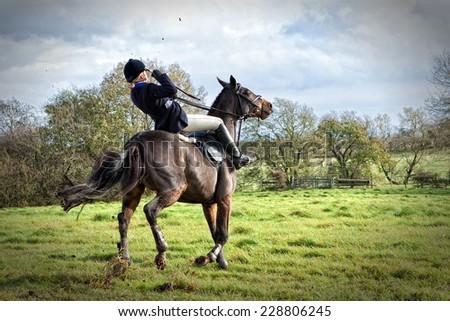 Horse rider falling off horse - stock photo