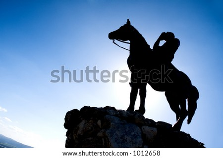 Horse rider silhouette on cliff