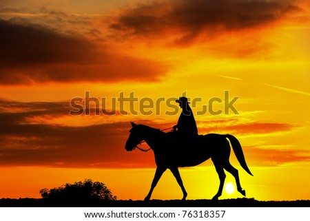 Horse riding at sunet - stock photo