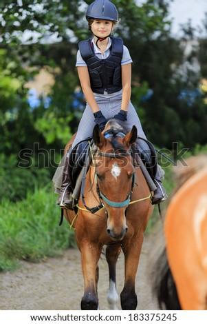 Horse riding, equestrian girl  - stock photo
