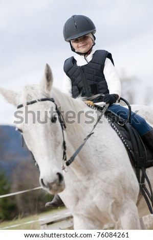 Horse riding - little jockey is riding a horse - stock photo