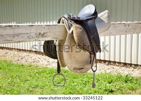 Horse saddle prepared for riding - stock photo