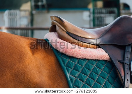 horse saddle - soft focus with film filter - stock photo