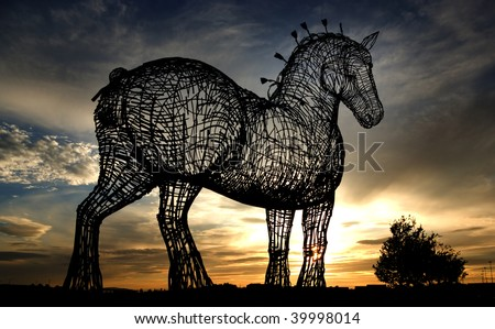 Horse sculpture at side of M8 motorway in Glasgow, Scotland, UK. Shot at sunset. - stock photo