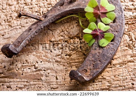 Horse-shoe and clover, vintage symbols of good fortune - stock photo