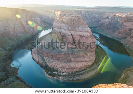 Horse shoe bend in Arizona with sun burst with Lens flare - stock photo