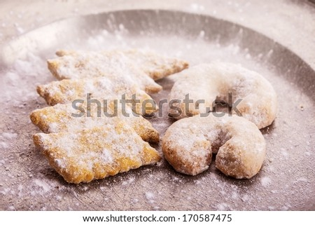 horse-shoe shaped homemade vanilla cookies on metal plate