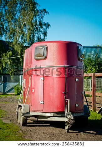 horse transport on a territory of stables - stock photo