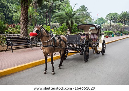 Horse with carriage in Intramuros, Manila, Philippines - stock photo