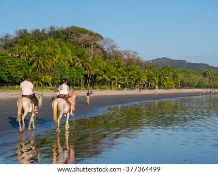 Horseback Riding in Costa Rica at Samara Beach - stock photo