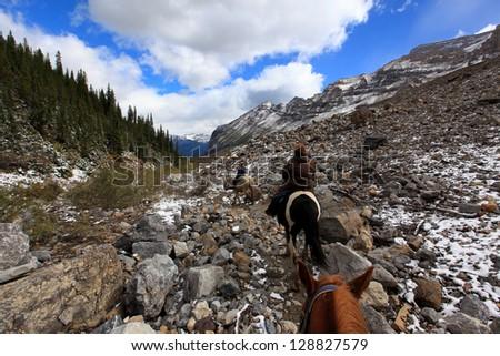 horseback riding in plain of six glaciers alberta canada - stock photo