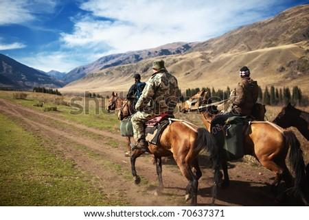 Horseback Riding in the Kazkahstan mountain - stock photo