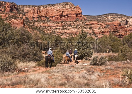 Horseback riding into Sedona's Red Rock Country - stock photo