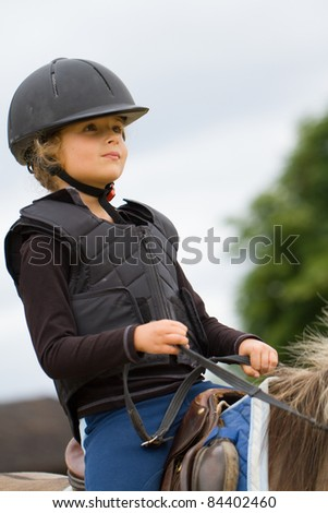 Horseback riding - little girl is riding a horse