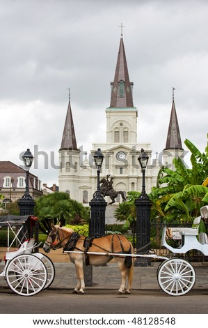 Horsedrawn carriages on Jackson square with St Louis cathedral, New Orleans - stock photo